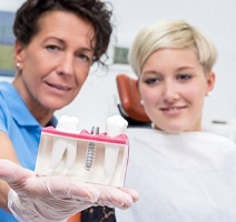 older man discussing cost of dental implants in Clarendon Hills with dentist