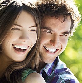 Smiling man and woman outdoors