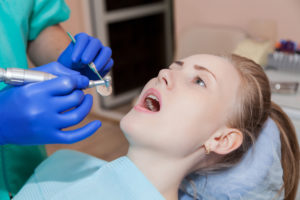 woman mouth open to receive treatment