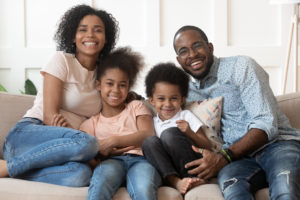 Happy, smiling family with optimum oral health